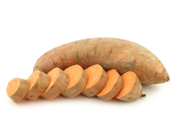 sweet potato and a cut one on a white background