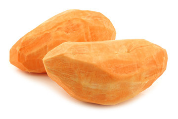 two whole peeled sweet potatoes on a white background