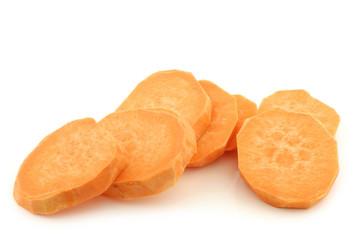 cut sweet potato slices on a white background
