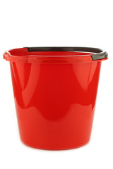 empty red plastic household bucket with a grey handle on a white