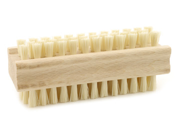wooden nail brush on a white background