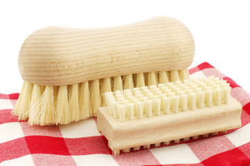 a wooden nail brush and a wooden household brush