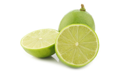 lime fruit and a cut one on a white background