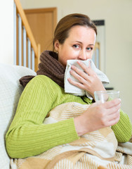 Portrait of sick woman at home