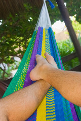 Relax on  a colorful hammock  in a tropical garden