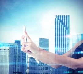 Woman photographs futuristic city