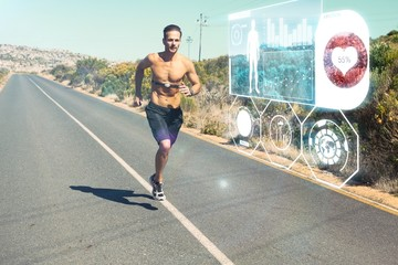 Athletic man jogging on open road with monitor around chest