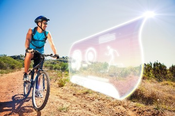 Composite image of fit cyclist riding in the countryside