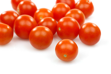 fresh whole cherry tomatoes on a white background