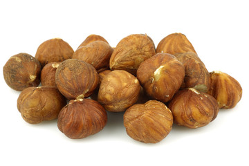 bunch of fresh hazelnuts on a white background