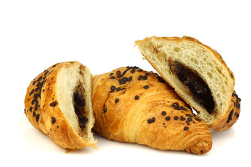chocolate sprinkled and filled fresh croissant on a white backgr