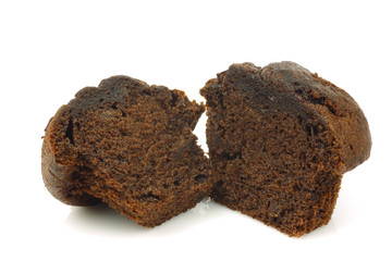 freshly baked cut chocolate muffin on a white background
