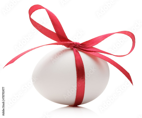 Easter egg with festive red bow isolated on white background - 78792477