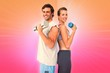 Fit couple exercising with dumbbell