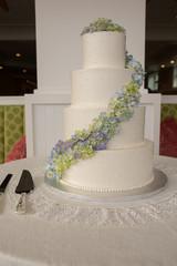 blue green flowers on wedding cake