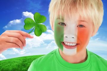 Composite image of cute irish boy