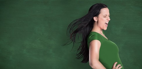 Composite image of brunette in green tshirt