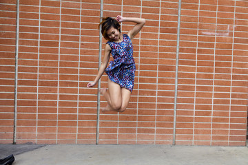Skinny Asian American Woman Jumping In Dress