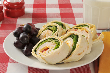 Chicken wrap sandwich and grapes