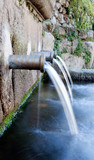 Source of three pipes with crystal clear water - 78795671