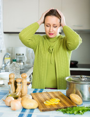 Sad female at kitchen