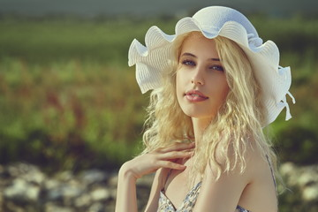 Gorgeous young lady wearing white sun hat