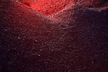 Heaps of coal in the red light