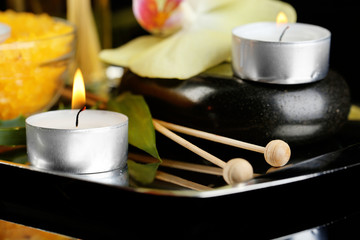 Beautiful spa composition with candles and orchid