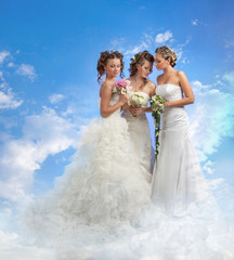 Three Brides Standing with Wedding Bouquets on Clouds