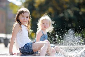 Two little sisters having fun