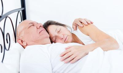 Beautiful elderly couple sleeping