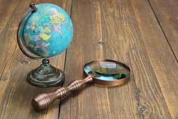 Vintage Globe Map and Magnifying Glass