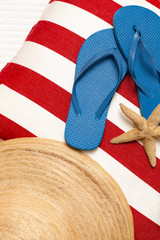 Flip flops, hat, towel, starfish for a day at the beach, pool or