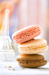 Macaroon cookies in a stack with the Eiffel Tower in the backgro