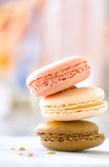 Macaroon cookies in a stack of three with selective focus and ba