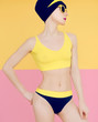 Girl in fashionable sport swimsuit and fashion accessories