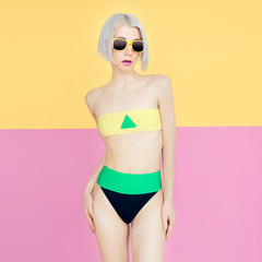 Blond model in fashionable bright swimsuit. Trend of the summer
