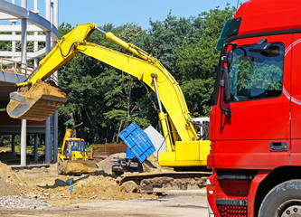 Excavator and a truck at the construction site