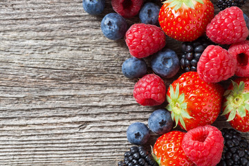 wooden background with fresh berries