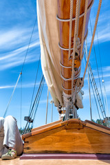 Detail of sailboat boom from below with close up of polished woo