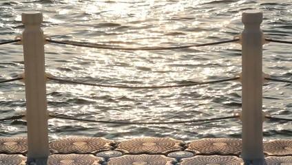 golden sunset reflection on pier