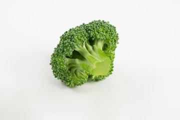 Fresh raw broccoli isolated on white background
