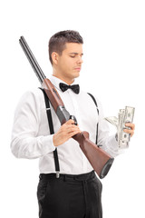Man with shotgun counting money