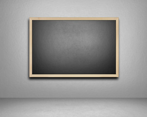 Blank blackboard on cement background