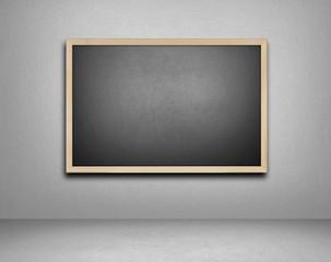 Blank blackboard on cement background