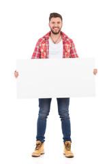 Smiling man holding placard