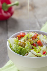Salad with oil in Bowl