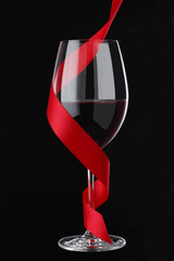 Red Wine with Red Ribbon on black