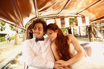 Bride and groom in a car in Paris, France