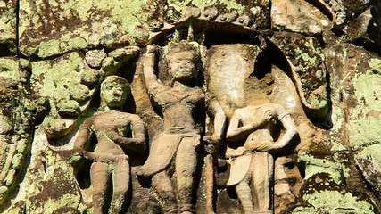 Zoom out-  Stone Carving of Religious Icons on Temple Wall - Angkor Wat, Cambodia